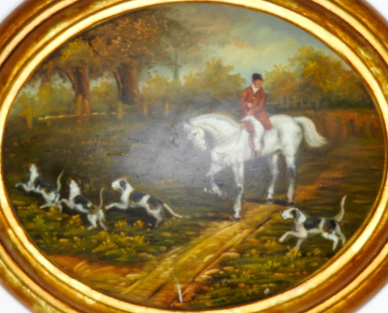 Featured is a 19th century oil painting on wood depicting an English hunting scene. This gorgeous piece is rich in detail and color with the hunting dogs in the foreground and a beautiful depiction of cloudy skies and trees in the background with