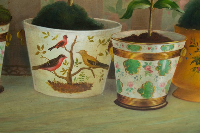 This soft and sophisticated still life depicts a series of potted floral plantings in decorated planters. Signature indistinctly in the lower left corner, early 20th century.