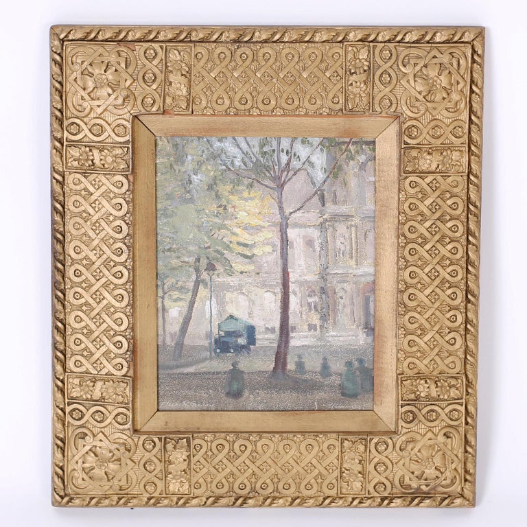 Impressionist oil painting on board of a Paris street scene with figures, trees, and architecture signed in the lower right Nimmo 53 and presented in an antique carved wood frame.  Actual painting is 10