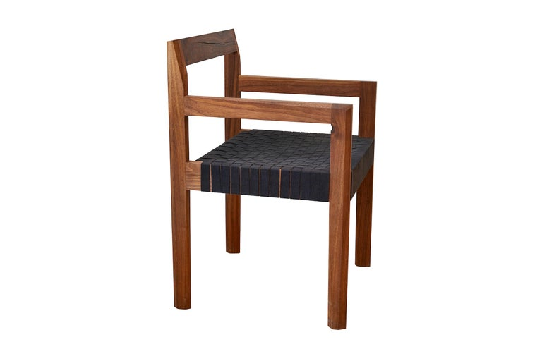 The faceted dining chair with arms. Featuring handwoven black shaker tape seat. Made in the USA by Casey McCafferty.