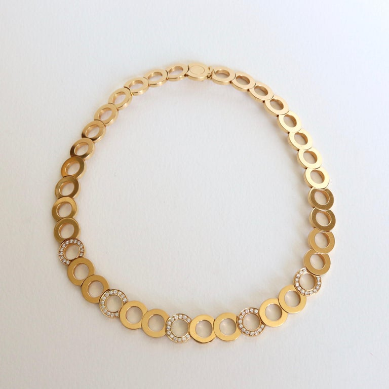 O.J. PERRIN Set of a Necklace and a Pair of Circles Motif Earrings in 18 Carat yellow Gold and Diamonds:  The Necklace has five Circles paved with 13 Diamonds for a Weight of approximately 1.3 Carats. Gross Weight 91 g Length: 38.5 cm or diameter