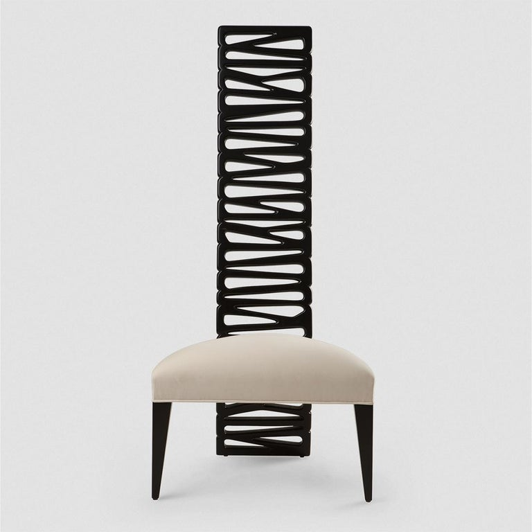 Chair Okawa with structure in solid mahogany wood hand carved and in black satin finish. With upholstered seat covered with fabric Agra high quality fabric. Available with other fabrics on request and also available in coffee Java finish paint or in