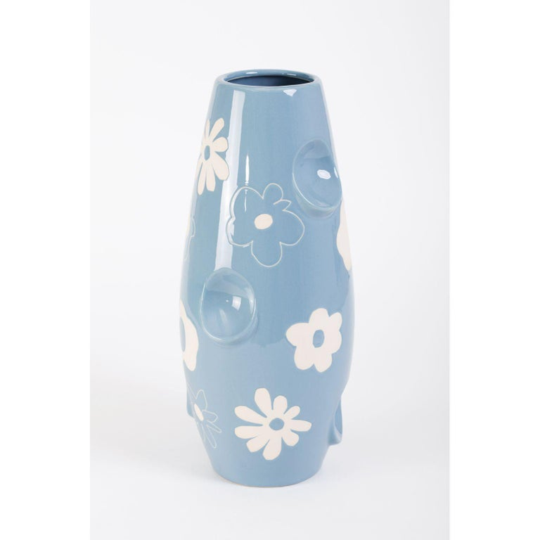 Oko Pop ceramic vase - Denim Daisy by Malwina Konopacka Unique Sculpture ( Decorated and hand-painted by the artist ) Materials: Ceramic, Blue Glaze Dimensions: D19, D42 cm  Also Available: Circus, Mushroom, Smiley   OKO came first and lent