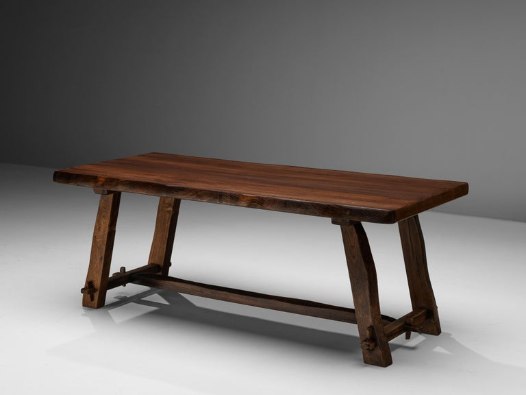 Olavi Hanninen for Mikko Nupponen, dining table, stained elm, Finland, 1950s   This rustic dining table by Finish designer Olavi Hanninen features a wonderful composition of strong lines and organic edges. The thick tabletop rests on four sloping
