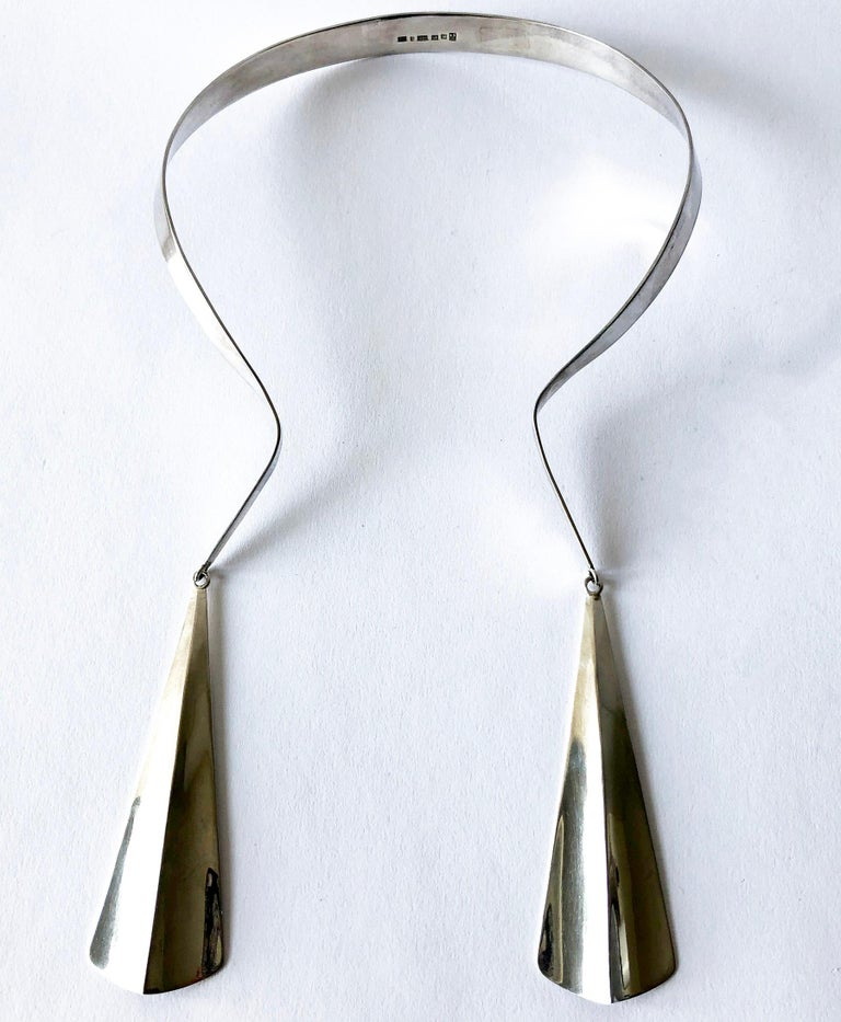 Sterling silver torque statement necklace with silver drops by Olavi L. Wehmersuo for Kaunis Koru, Finland.  Necklace will fit up to a 17