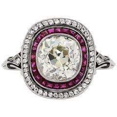 Old Cushion Cut Diamond and Ruby Engagement Ring