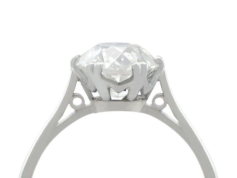 A stunning, fine and impressive antique 2.31 carat old cut diamond and platinum solitaire style engagement ring; part of our antique diamond engagement ring collections.  This fine antique diamond solitaire ring has been crafted in platinum.  The
