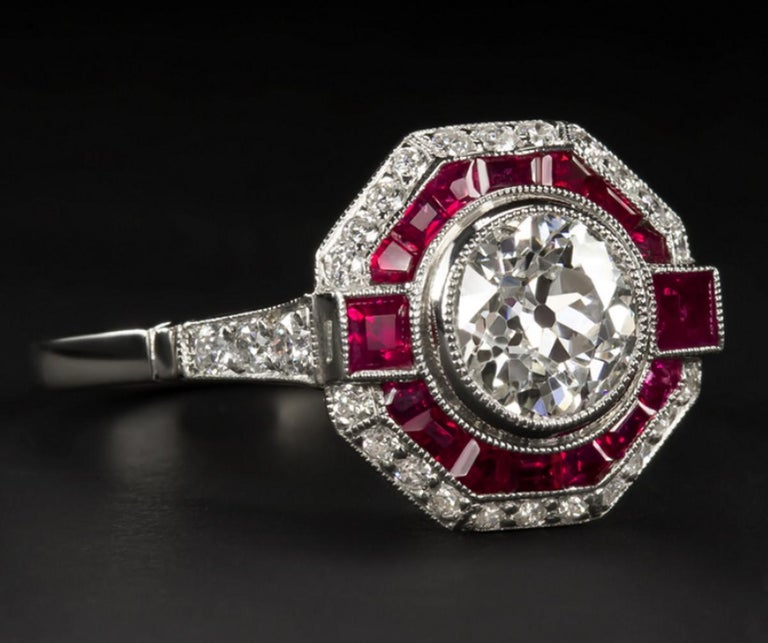 Beautiful ring with an amazing old European cut diamond weighing 1.05 ct. The frame is in platinum and is studded with rubies. The center stone was cut by hand during the 1920s and 1930s.  The ring is of recent construction, and is the work of