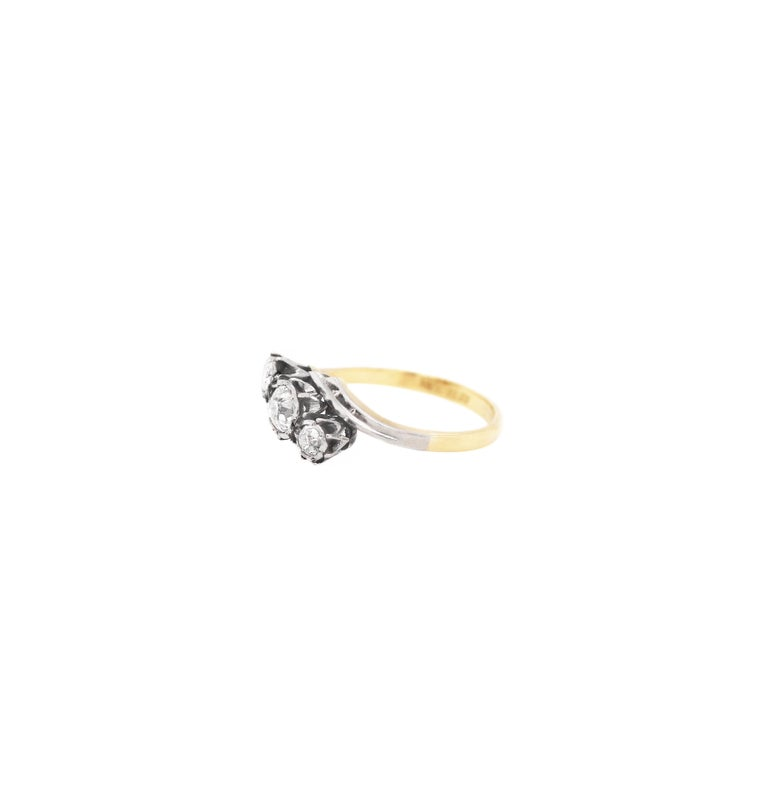 Art Deco Old Cut Three-Stone Twist 18 Carat Gold and Platinum Ring, circa 1920s For Sale