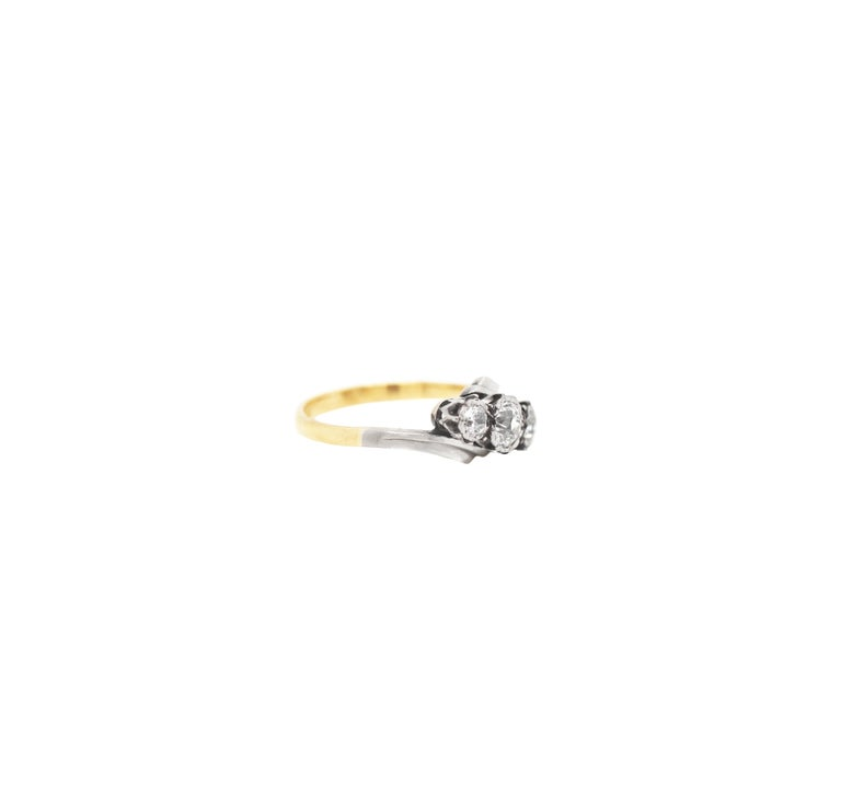 Old Mine Cut Old Cut Three-Stone Twist 18 Carat Gold and Platinum Ring, circa 1920s For Sale