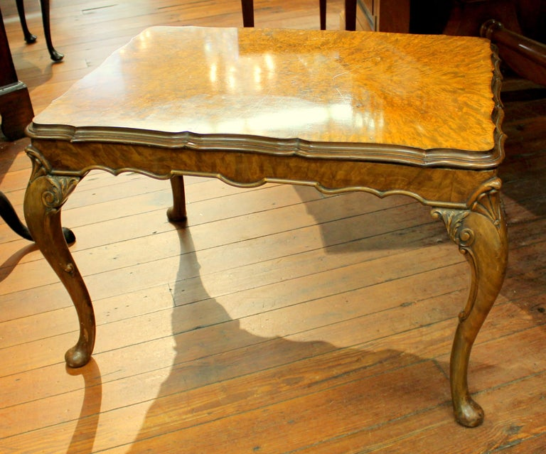 Fine old English burr walnut Georgian style carved coffee table with exquisite, highly figured book matched burr walnut. (Some old scratches noted and illustrated). Exceptional hand-carved cabriole legs. Wonderfully useful size.
