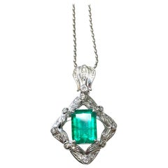 Old English Inspired Emerald Cut Emerald and White Diamond Necklace in Platinum