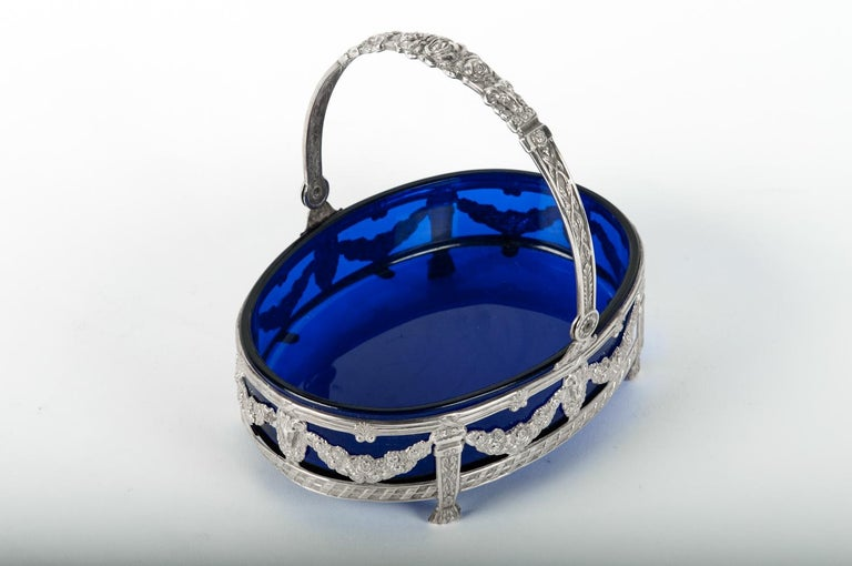Old English sterling silver framed footed barware or tableware dish with cobalt blue glass liner. The piece is in great condition. Minor wear consistent with age or use. The dish stands about 6 inches high x 6.5 inches diameter.