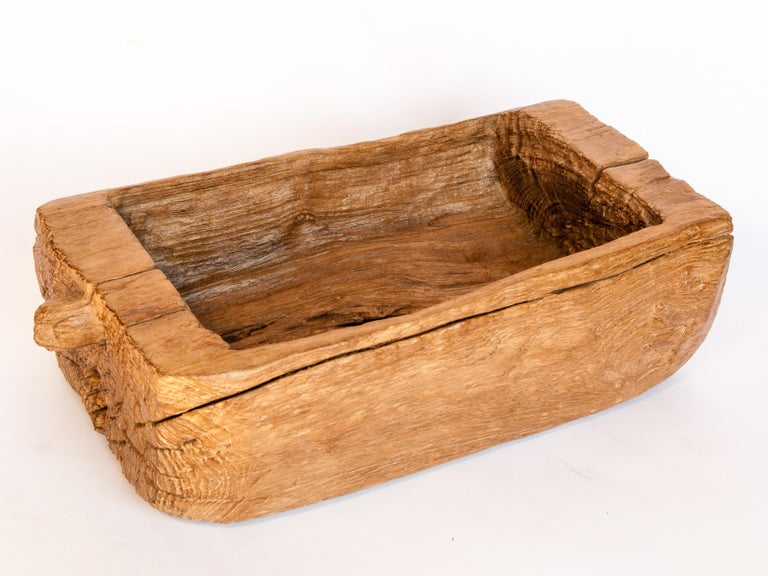 An old eroded teak trough or planter. From North Thailand, mid-20th century.