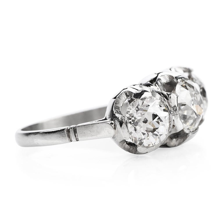 Vintage, sparkly & full of life, this three-stone diamond engagement ring is perfect for creating memories.  Crafted in solid Platinum, the center is adorned by a (3) Old European cut, Half bezel-set, high-quality genuine diamonds weighing in total