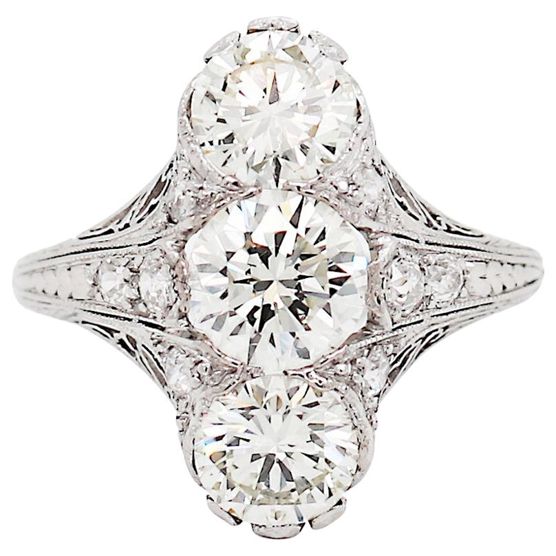 Old European Cut Diamond Vertical Three-Stone Diamond Filigree Platinum Ring
