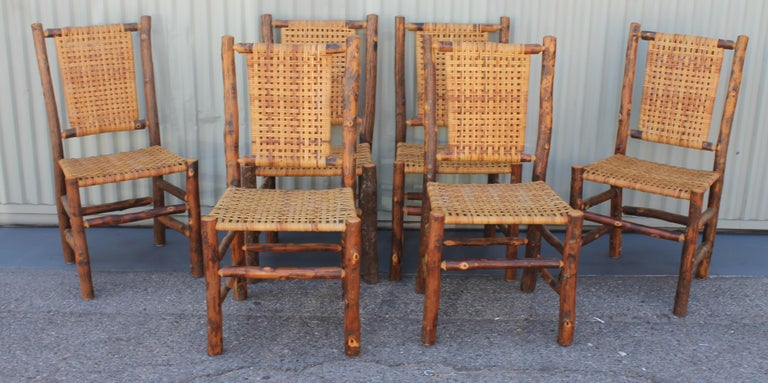 This set of Old Hickory chairs are late but great. Probably from the 1950s or 1960s but in fine condition. The seats and backs are all original.
