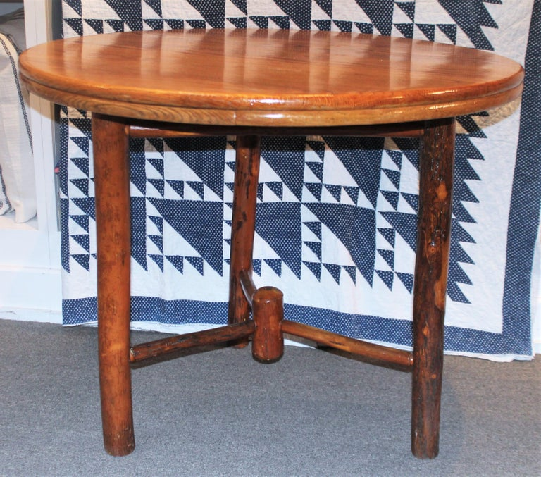 Early 20th century round hickory dining table. Old hickory manufacture. Has been sealed to protect wood from all weather. This item has been checked for strength and stability.