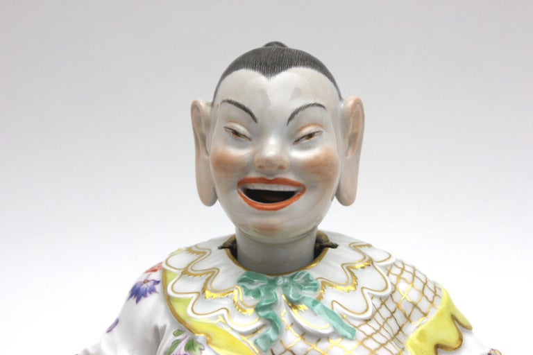 Old Meissen porcelain figure as Wiggle Pagoda with gold and flower painting.  The porcelain Pagoda have movable hands and movable head.   Design by Johann Joachim Kaendler.   Meissen after 1930 with rich gold and flower painting.    The