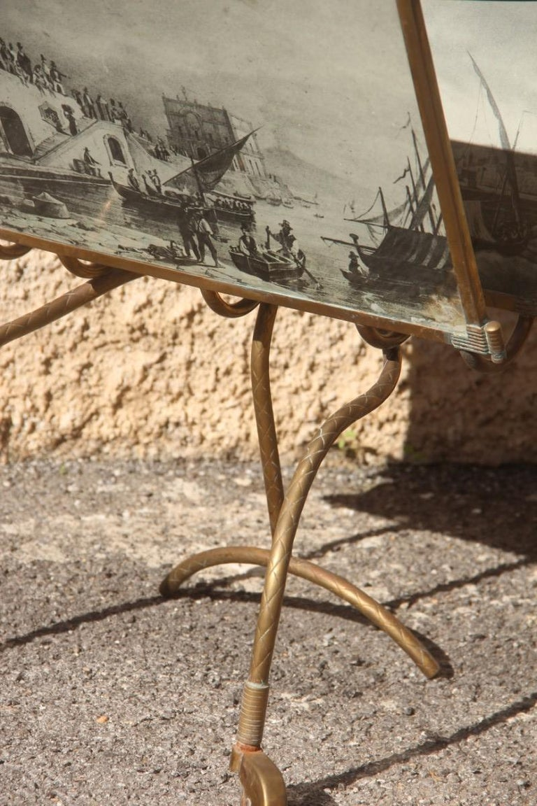 Mid-Century Modern Italian design brass magazine rack and vintage prints, 1950s, Particular form. On request the brass part can be polished, without any additional cost.