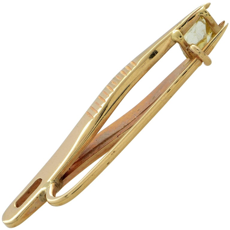 Diamond Tweezer Brooch featuring a fancy yellow mine cut diamond weighing approximately .35cts. This delightful brooch is for the diamond connoisseur and collector eclectic pieces. This fabulous pin measures 1.2 inches in length.   Our pieces are
