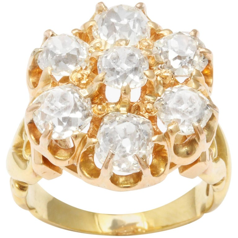 Seven white diamonds, brilliant Old Mine Cuts, make an imposing impression in this Victorian ring c. 1880.. I had to breathe deeply when I saw it. It has a beauty that takes over. Age adds to its beauty giving the ring has an individual rather than