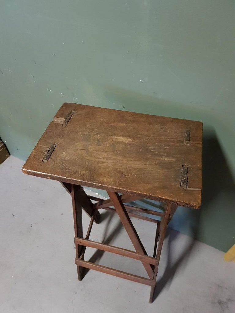 Old oak work table that was probably once made by someone, because of its patina it has a beautiful appearance and very decorative as a pedestal / console for an art object. Originating from the early 20th century or late 19th century.  The