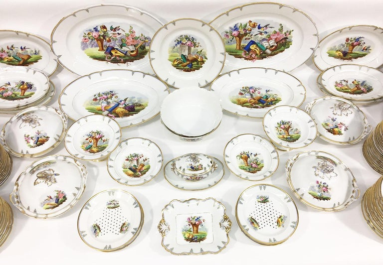 """""""Old Paris"""" porcelain dinner service  188 pieces tableware (200 parts)   19th century French porcelain.  Beautiful white porcelain with blue and gold painted border and in the center several decorations of flowers in a vase, different kinds of"""