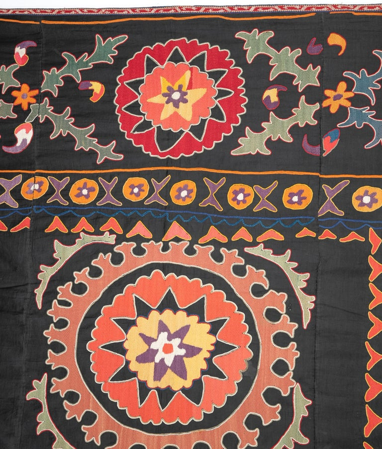 It is a finely embroidered example with a bold design. Silk embroidery on cotton.