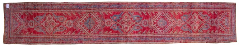 Rare size for this antique beautiful Turkish runner: its typical red color is suitable for the spaces with little light, like corridors; but the color explodes in the sunlight!