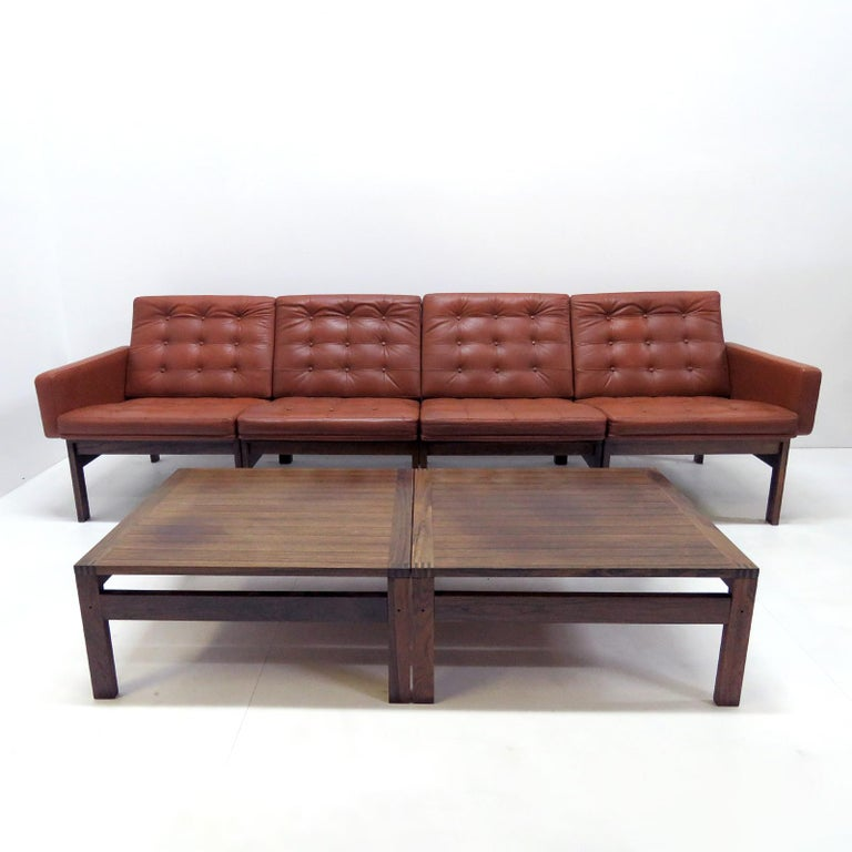 Moduline sofa set designed by Ole Gjerlov Knudsen & Torben Lind, manufactured by France & Son, Denmark 1962. This modular set contains four seating elements, (two of which with one arm each) and two low solid rosewood side tables. The sofa has a