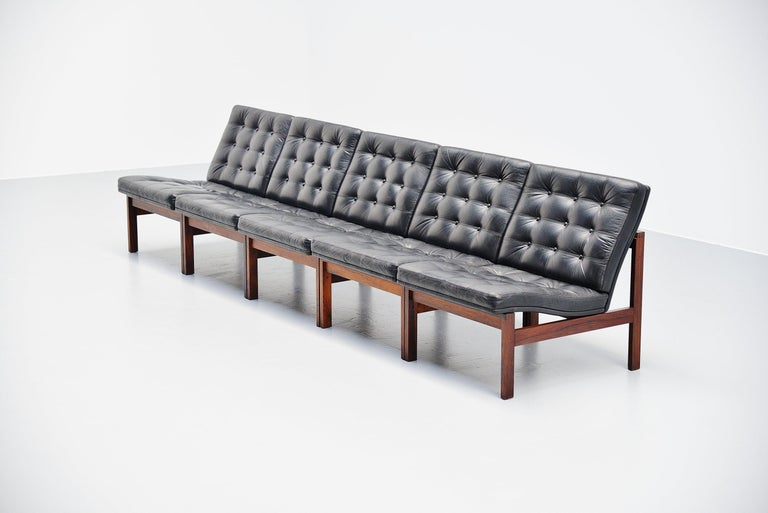 Moduline sofa designed by designer duo Ole Gjerlov Knudsen and Torben Lind. Manufactured by France & Son, Denmark 1962. The sofa has a solid rosewood frame and black leather seats with tufted pattern at the front. The leather is still in great
