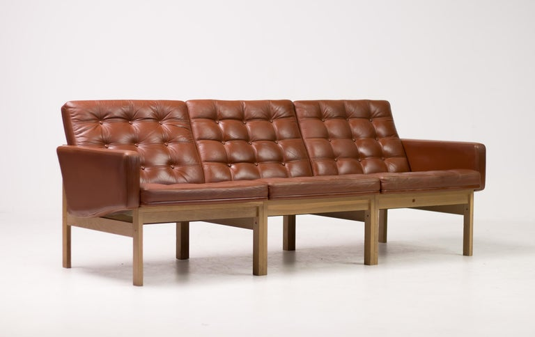 Ole Gjerløv-Knudsen & Torben Lind for France & Søn sofa in oak and cognac colored leather, Denmark, 1962.