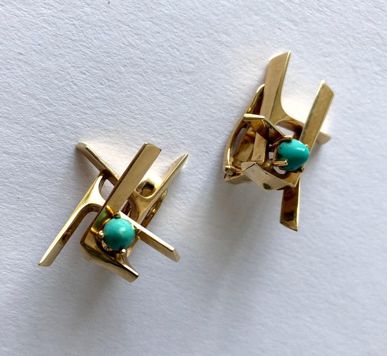 1970's 14k gold earrings with high domed Persian turquoise cabochons created by Ole Lynggaard of Copenhagen, Denmark.  Earrings are of the clipback variety and could be converted by a competent jeweler of your choice.  They measure 1 1/8