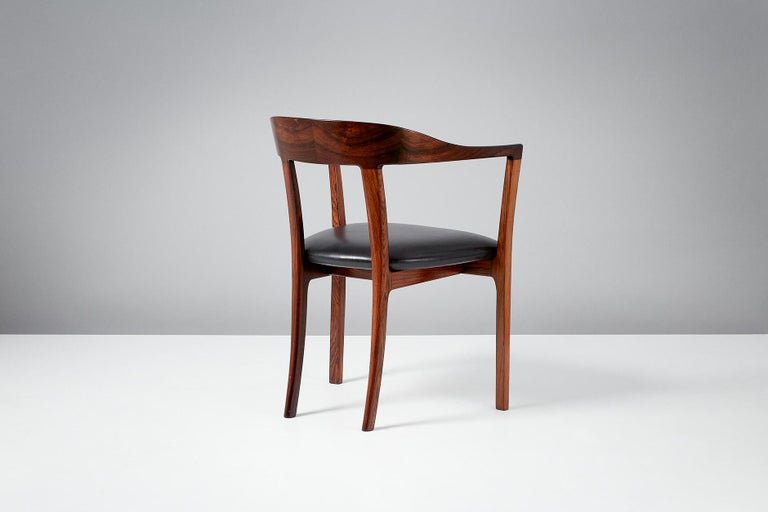 Ole Wanscher  J2883 armchair, 1958  Produced by master cabinetmaker A.J. Iversen in sumptuous Brazilian rosewood with aniline black leather seat. First presented at the Copenhagen Cabinetmakers' Guild in 1958. A rarely seen and highly