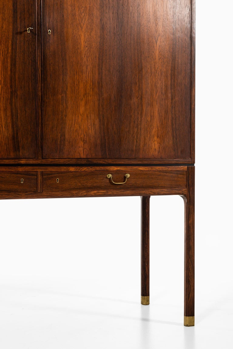 Very rare cabinet in rosewood and brass designed by Ole Wanscher. Produced by cabinetmaker A.J Iversen in Denmark.