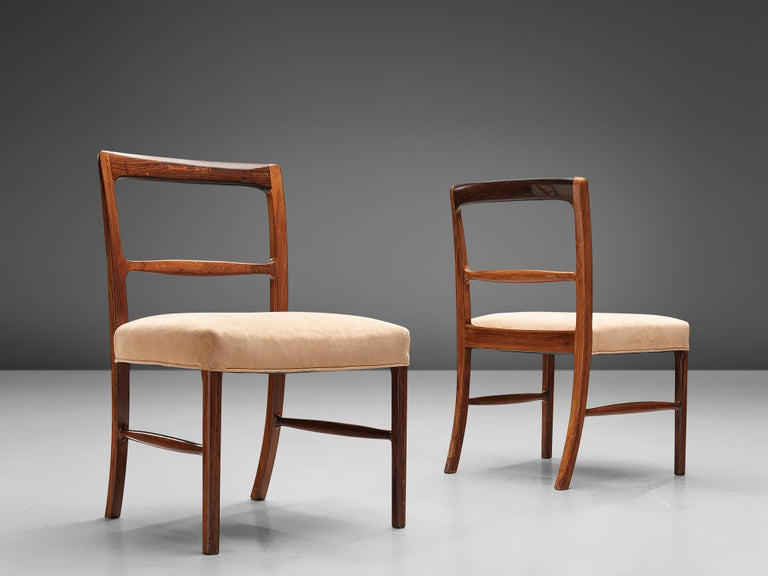 Ole Wanscher for AJ Iversen, set of eight dining chairs, rosewood and beige upholstery, Denmark, 1963.  A luxurious dining set in rosewood, consisting of six dining chairs and two armchairs. The 'Forum' model shows the high level of craftsmanship