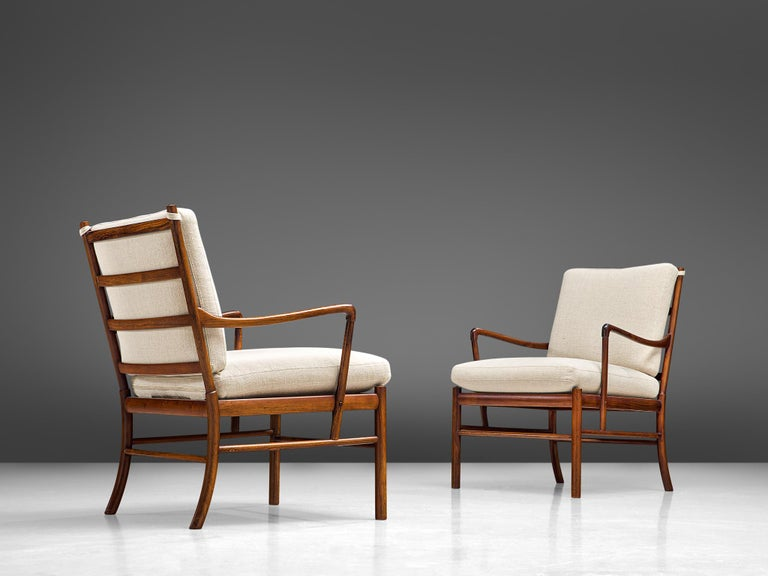 Ole Wanscher for Poul Jeppesen, pair of 'Colonial' armchairs, rosewood, cane and fabric, Denmark, 1949  Elegant pair easy chairs with a slim, rosewood frame by the Danish designer Ole Wanscher. These chairs show the great craftsmanship and attention