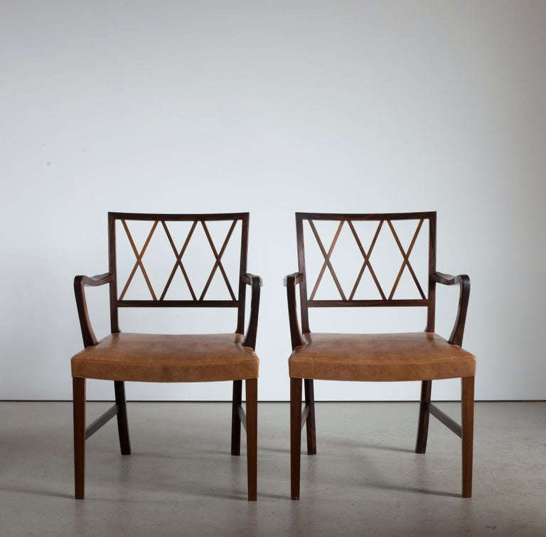 Ole Wanscher pair of armchairs in rosewood and leather. Executed by A. J. Iversen, Copenhagen, Denmark.