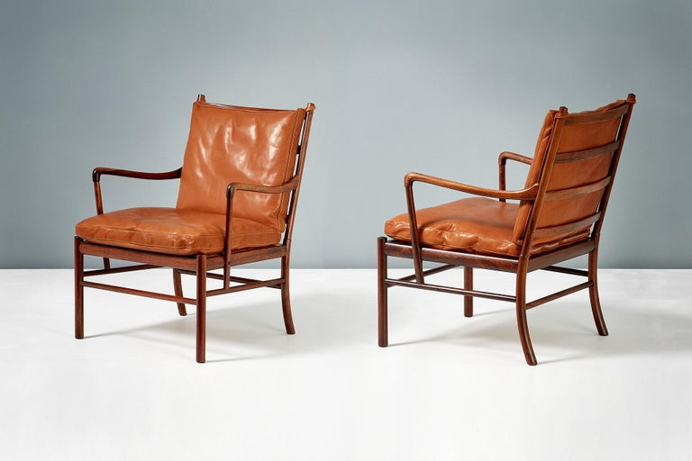 Ole Wanscher  PJ-149 Colonial chairs, 1949.  These examples made from Brazilian rosewood with woven rattan cane seats. Produced by Poul Jeppesen, Denmark, circa 1950s. Cognac brown aniline leather seat cushions with loose feather filling.
