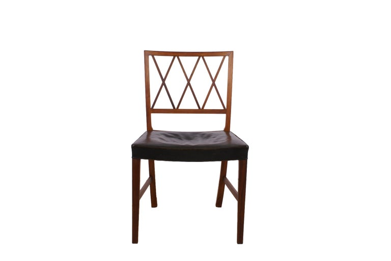 Ole Wanscher, set of 8 dining chairs in Brazilian rosewood for master cabinetmaker A.J. Iversen. Seat in original patinated black leather. With metal tag from Illums Bolighus.  Shipping worldwide is possible for these rosewood chairs as seller can