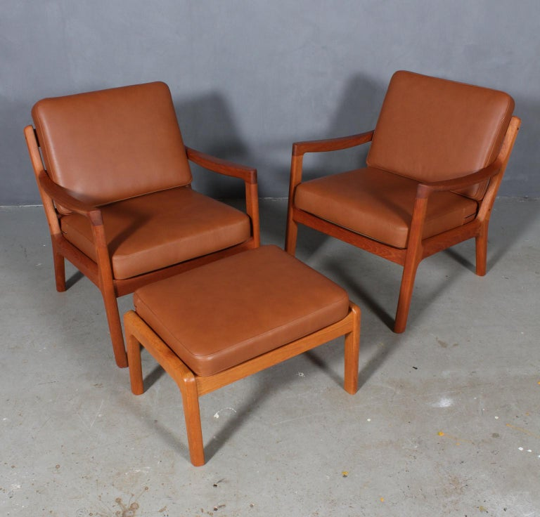 Ole Wanscher set of lounge chairs with ottoman new upholstered with tan aniline leather.
