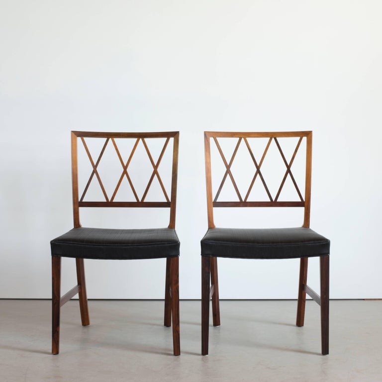 Set of six dining chairs by Ole Wanscher. Executed by A. J. Iversen for Illums Bolighus, Copenhagen, Denmark.