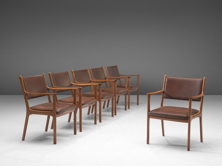 Ole Wanscher for P. Jeppesens Møbelfabrik, set of six armchairs model 'PJ412', mahogany, leather, Denmark, 1960s   Modest set of dining chairs designed by Ole Wanscher in the 1960s. These chairs are very comfortable thanks to the remarkable wide