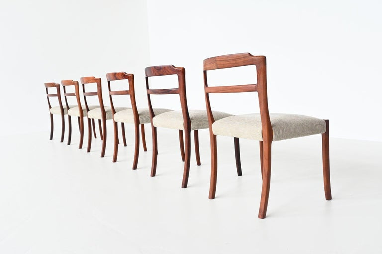Gorgeous set of six dining chairs designed by Ole Wanscher and manufactured by A.J. Iversen, Denmark 1960. These very nice shaped dining chairs are made of beautiful grained solid rosewood and they are upholstered with cream white ribbed fabric. The