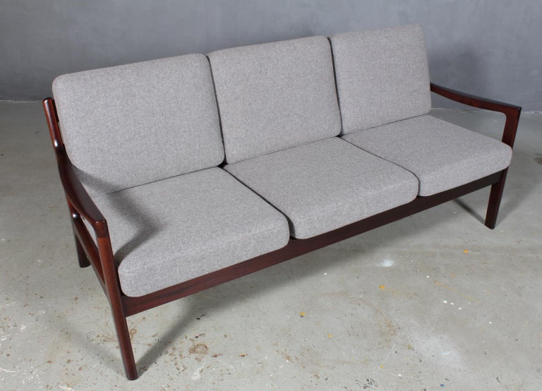 Ole Wanscher three-seat sofa new upholstered with light grey 100 % New Zealand Divina wool.  Made of solid mahogany.  Model Senator, made by France & Son.