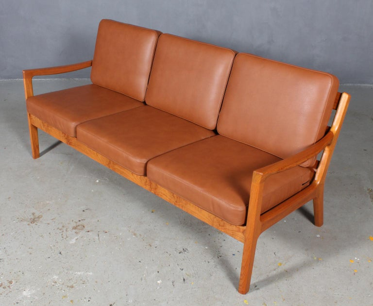 Ole Wanscher three-seat sofa new upholstered with tan aniline leather.  Made of solid teak.  Model senator, made by Cado.