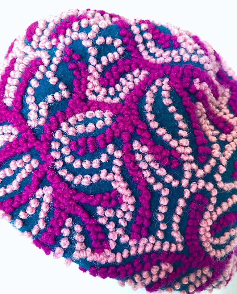 Exquisite 1960s OLEG CASSINI navy blue, fuchsia and pink virgin wool cloche hat! Features hand embroidery with so much detail. Looks amazing on, and has stretch to fit most sizes. In great condtion. Made in Italy Measurements: 10-11 inches from
