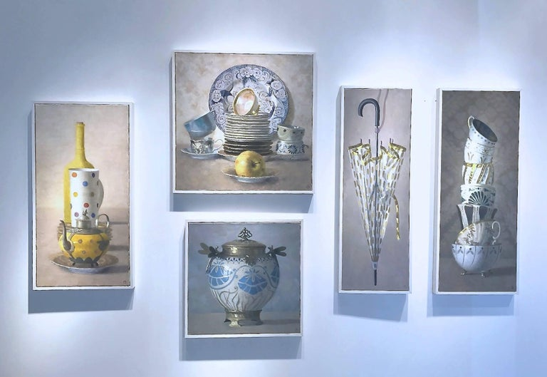 Olga Antonova's subject is compositions of extraordinarily elegant and beautiful cups, plates, teapots, and dishes, but there is something whimsical about these paintings that belies their formality:  stacked teacups are also amusing, having a kind