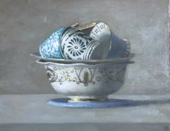 """Blue, White and Gold Cups Stacked in a Gold and White Bowl"""